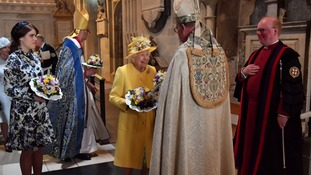 Queen Elizabeth II with Princess Eugenie leaving St George's Chapel in Windsor after the annual Royal Maundy Service.