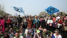 Climate change protesters target Easter sun seekers