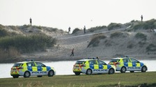 Good Friday beach horror: Schoolboy, 14, is knifed in the stomach at packed beach