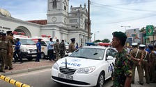 Sri Lankan Army soldiers secure the area around St. Anthony's Shrine after a blast in Colombo