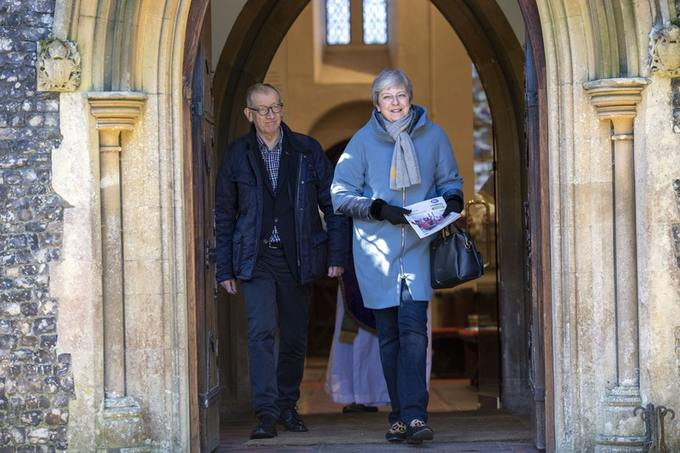 Prime Minister Theresa May, pictured with husband Philip, said everyone of faith should be allowed to follow their beliefs in safety