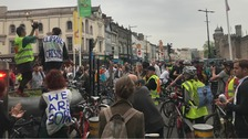 Extinction Rebellion protestors gather in Cardiff during rush hour