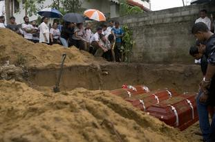 Relatives bury three members of the same family
