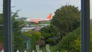 People living near Southend Airport protest about commercial jets at the bottom of their gardens