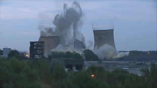 Three towers at Didcot Power Station being demolished in 2014