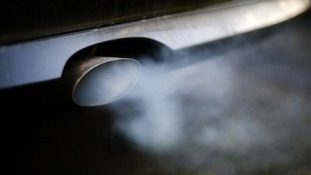 Exhaust pipe with fumes coming out of car