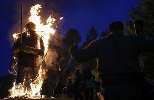 Crowds look on as the wickerman is set alight.