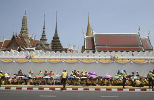 Wellwishers gather outside the Grand Palace for the three-day ceremony.