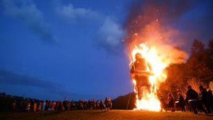 Members of the Pentacle Drummers perform in front of the burning wickerman during the Beltain Festival.