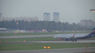 Emergency vehicles surround the Russian plane at Moscow's Sheremetyevo Airport.