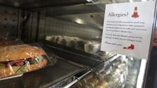 An allergy warning notice displayed next to food in a branch of Pret A Manger in central London