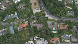An aerial view of the wealthy homes surrounding the mansion that was raided.