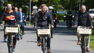 Prince Harry riding a bike in The Netherlands