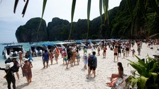 Tourists pictured enjoying the beach on Maya Bay.