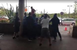 A brawl that erupted at a shopping centre after a vigilante group of 'paedophile hunters' confronted a man