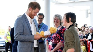 The Duke of Sussex is gifted a teddy bear by former patient Daisy Wingrove.