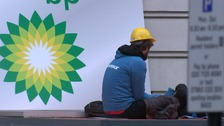 Greenpeace activists block BP's headquarters with concrete