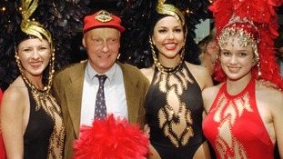 Niki Lauda, founder of Lauda Air, is greeted by a group of Showgirls after he arrives in Las Vegas in September 1997.