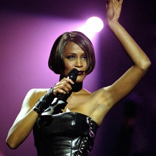 Whitney Houston performing at the 1999 Brit Awards, in the London Arena.