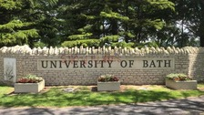 The graffiti on the University of Bath sign.