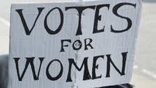 Votes for women placard