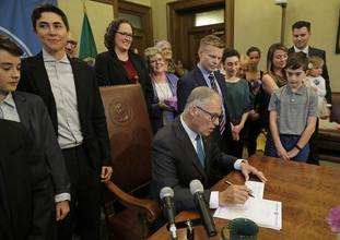 Washington Governor Jay Inslee signs the bill into law.