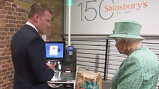 'You can't cheat?' Queen shown self-service during shop visit