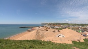 Thousands of tonnes of rocks being moved to West Bay in Dorset