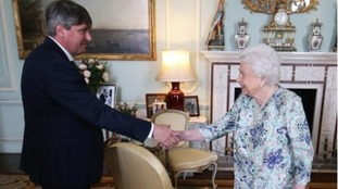 Queen Elizabeth II presents Simon Armitage with The Queen's Gold Medal for Poetry