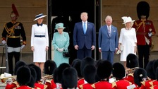 First Lady Melania Trump, the Queen, US President Donald Trump, the Prince of Wales and Duchess of Cornwall inspect the Guard of Honour.
