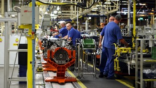 Engineers working on a Jaguar V8 engine at the Ford engine plant near Bridgend.