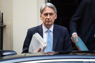 Chancellor Philip Hammond is said to be unhappy at Mrs May's plans for a series of big spending announcements