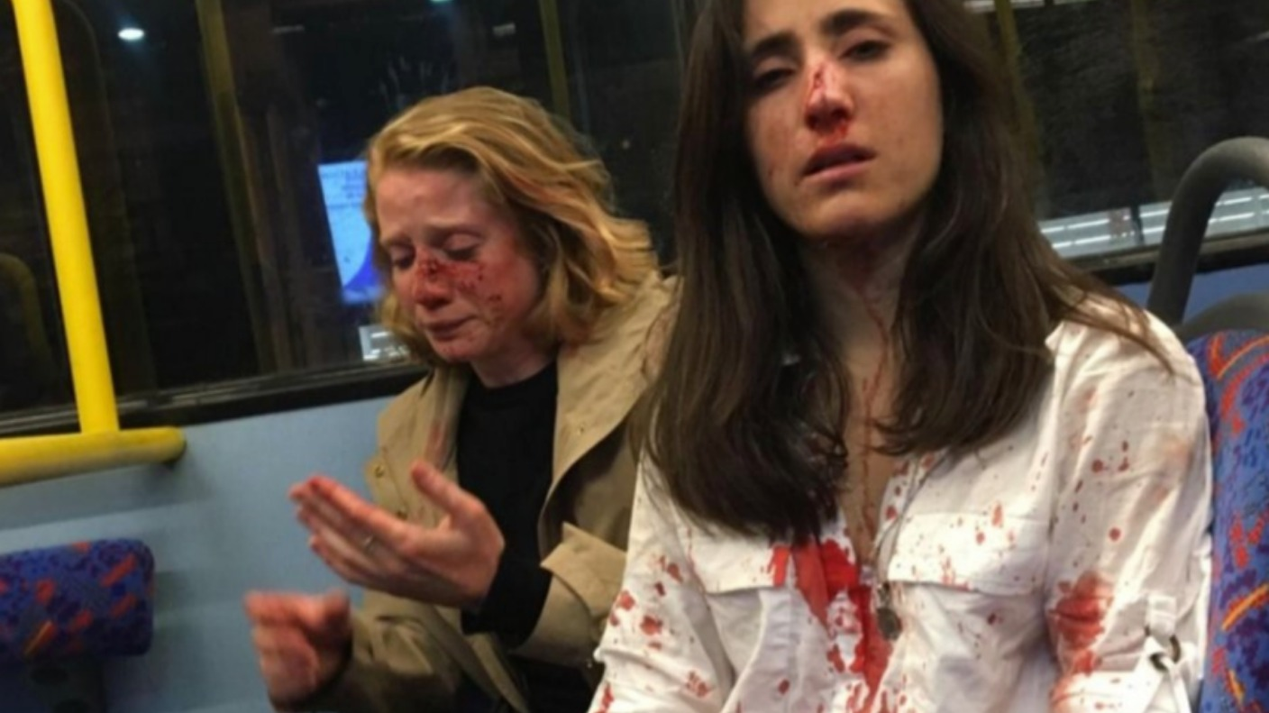 Woman And Girlfriend Attacked By Gang Of Men On Bus For