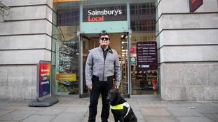 British Paralympic skiing champion John Dickinson-Lilley with his guide dog Brett.