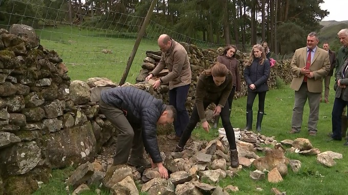 The Duke and Duchess of Cambridge in Cumbria countryside with farmers.