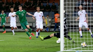 Paddy McNair scores for Northern Ireland past Belarus goalkeeper Aleksandr Gutor in their Euro 2020 qualifier