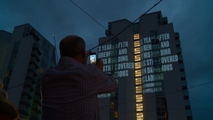 Grenfell survivors project safety messages onto Salford tower blocks