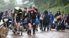 Drenched fans leaving Download Festival as heavy rain turns event into mudbath