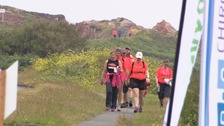 Islanders brave wet weather to walk 39 miles around Guernsey