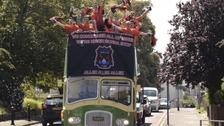 Duckpond FC celebrate on the bus.