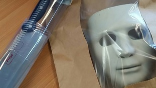 The mask and knife that were seized by police following the incident.