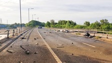 Driver flees scene of crash leaving debris on motorway
