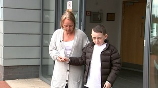 Tommi Morgan and his mother Josie outside hospital.