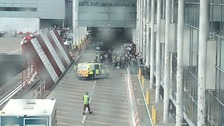People being allowed back into the airport after reports of a fire alarm.