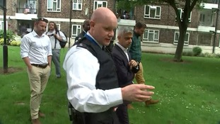London's mayor being shown around the estate in Tulse Hill