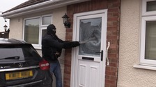 Northants Police smashing down one of the doors to a gang house during a drug bust.