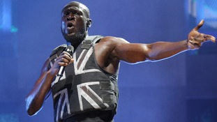 Stormzy opened his set wearing a Union Jack embellished stab vest.