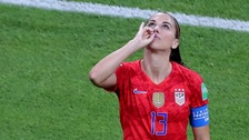 Alex Morgan celebrates making it 2-1 for USA against England.