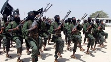 Hundreds of newly trained al-Shabab fighters perform military exercises in the Lafofe area some 18 km south of Mogadishu, in Somalia.