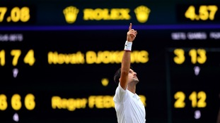 Djokovic celebrates after claiming his fifth Wimbledon title.